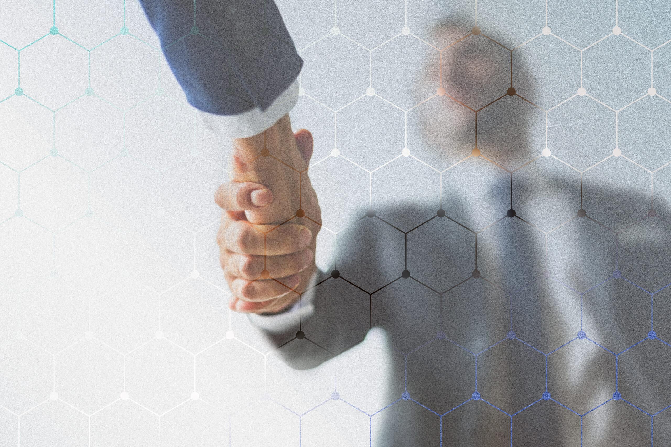 Corporate business handshake between partners